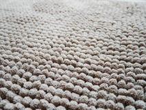 Ciérrese encima de fondo marrón de la alfombra Fotografía de archivo libre de regalías