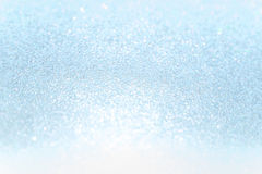 Ciérrese encima de fondo suave del extracto del bokeh del brillo del papel azul fotos de archivo libres de regalías