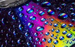 Ciérrese encima de gotas del agua en DVD Imagen de archivo libre de regalías