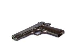 ciérrese encima de la arma de mano de la pistola aislada en el fondo blanco Foto de archivo libre de regalías