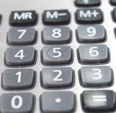 Ciérrese encima de la calculadora del diseño de negocio en oficina del trabajo Foto de archivo libre de regalías