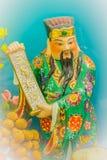 Ciérrese encima de la escultura de Cai Shen, dios chino de la riqueza, dios de las FO Fotografía de archivo libre de regalías