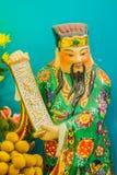 Ciérrese encima de la escultura de Cai Shen, dios chino de la riqueza, dios de las FO Imágenes de archivo libres de regalías