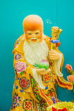 Ciérrese encima de la escultura de Cai Shen, dios chino de la riqueza, dios de las FO Imagen de archivo