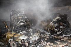 Ciérrese encima de la foto de los coches de un quemar Fotografía de archivo libre de regalías