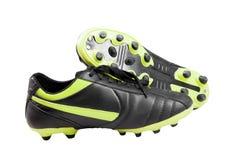 Ciérrese encima de la foto de los zapatos de un fútbol Fotografía de archivo