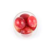 Ciérrese encima de la fruta de la uva en vidrio Imagen de archivo libre de regalías