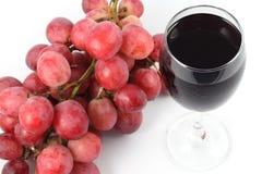 Ciérrese encima de la fruta de la uva y del vidrio de jugo Imagenes de archivo