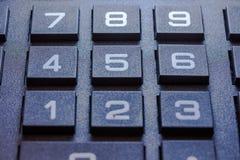 Ciérrese encima de la imagen del cojín del número de la calculadora Imagenes de archivo