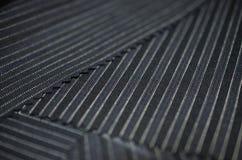 Ciérrese encima de la línea tela del negro del traje Imagen de archivo libre de regalías