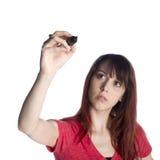 Ciérrese encima de la mujer joven que detiene al marcador Pen Up imágenes de archivo libres de regalías