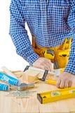 Ciérrese encima de la opinión sobre el trabajo del carpintero aislado Foto de archivo libre de regalías