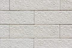 Ciérrese encima de la pared de ladrillo blanca Fotografía de archivo