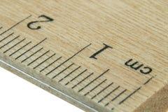Ciérrese encima de la regla de madera Foto de archivo libre de regalías