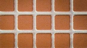 Ciérrese encima de la teja de mosaico cuadrada marrón Imagen de archivo