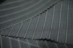 Ciérrese encima de la tela gris del traje Imágenes de archivo libres de regalías