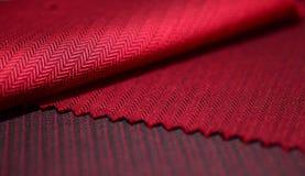 Ciérrese encima de la tela roja de la camisa Foto de archivo libre de regalías