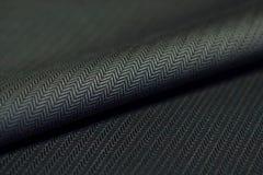 Ciérrese encima de la tela texturizada negro de la camisa Fotografía de archivo