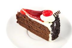 Ciérrese encima de la torta con la cereza Fotos de archivo libres de regalías