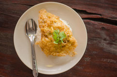 Ciérrese encima de la tortilla en el arroz Imagenes de archivo