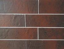 Ciérrese encima de la vista de los paneles de cerámica del granito del ladrillo de la teja hechos en el color del marrón Fragment Imagen de archivo