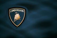Ciérrese encima de Logo Of Lamborghini en fondo azul marino Imágenes de archivo libres de regalías