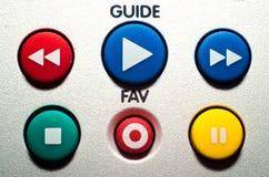 Ciérrese encima de los botones coloridos remotos de la TV Imagenes de archivo