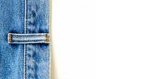 Ciérrese encima de los pantalones vaqueros del dril de algodón foto de archivo