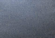 Ciérrese encima de modelo del fondo de la textura azul del dril de algodón Imagen de archivo libre de regalías