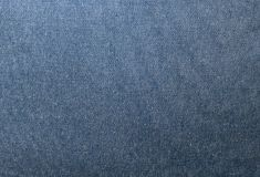 Ciérrese encima de modelo del fondo de la textura azul del dril de algodón Fotos de archivo libres de regalías