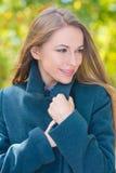 Ciérrese encima de mujer sonriente en Gray Coat Attire Imágenes de archivo libres de regalías