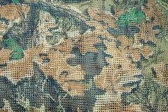 Ciérrese encima de tela de malla del soldado de la textura del modelo Foto de archivo