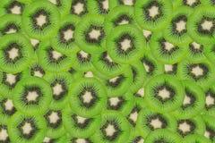 Ciérrese encima de textura de las rebanadas del kivi Imagen de archivo libre de regalías