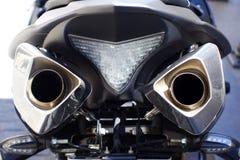 Ciérrese encima de tiro de los tubos de escape de la motocicleta Imagen de archivo