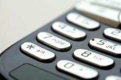 Ciérrese encima de tiro del telclado numérico móvil bajo luz Imagen de archivo libre de regalías