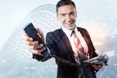 Ciérrese encima de un receptor del teléfono que le es dado Fotografía de archivo libre de regalías