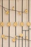 Ciérrese encima de ventana con la parrilla de las barras de hierro en la puerta de madera Fotografía de archivo