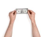 Ciérrese encima de vista de un man& x27; s da llevar a cabo los billetes de dólar uno en el fondo blanco Imagen de archivo