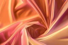 ciérrese encima de vista de la tela sedosa rosada elegante imagenes de archivo