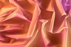 ciérrese encima de vista de la tela sedosa rosada elegante imagen de archivo libre de regalías