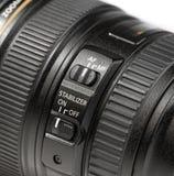 Ciérrese encima del botón del estabilizador en la lente Fotografía de archivo libre de regalías