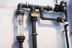 Ciérrese encima del contador del agua de la etiqueta Fotografía de archivo