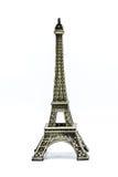 Ciérrese encima del modelo del recuerdo de la torre Eiffel en el fondo blanco imagenes de archivo