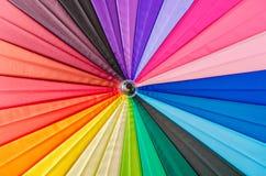 Ciérrese encima del paraguas del arco iris Imagenes de archivo