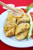 Ciérrese encima del queso de soja chino y del cerdo fritos Foto de archivo libre de regalías