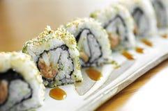 Ciérrese encima del sushi del atún y del arroz Foto de archivo