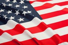 Ciérrese encima del tiro del estudio de las banderas rizadas - los Estados Unidos de América Fotos de archivo