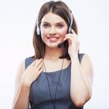 Ciérrese encima del trabajador del servicio de atención al cliente de la mujer, ope sonriente del centro de atención telefónica Foto de archivo