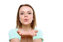 Ciérrese para arriba de beso que sopla de la mujer bonita Imagen de archivo
