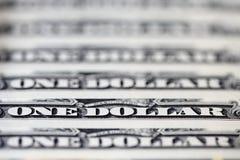 Ciérrese para arriba de billetes de dólar de los E.E.U.U. uno Un fondo de los billetes de banco del dólar Fotos de archivo libres de regalías